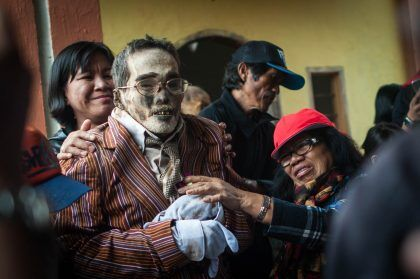 *** EDITOR'S NOTE: GRAPHIC CONTENT *** TORAJA, INDONESIA - AUGUST 26: Relatives clean the body of Paul Sampe Lumba who has been dead for seven yeas during the Ma'nene ritual at Panggala Village on August 26, 2016 in Toraja, Indonesia. The Ma'nene ritual in performed during a ceremony every three years, where the dead are exhumed for a change of clothes, among the people of Toraja as an expression of the love of the surviving family. PHOTOGRAPH BY Sijori Images / Barcroft Images London-T:+44 207 033 1031 E:hello@barcroftmedia.com - New York-T:+1 212 796 2458 E:hello@barcroftusa.com - New Delhi-T:+91 11 4053 2429 E:hello@barcroftindia.com www.barcroftimages.com